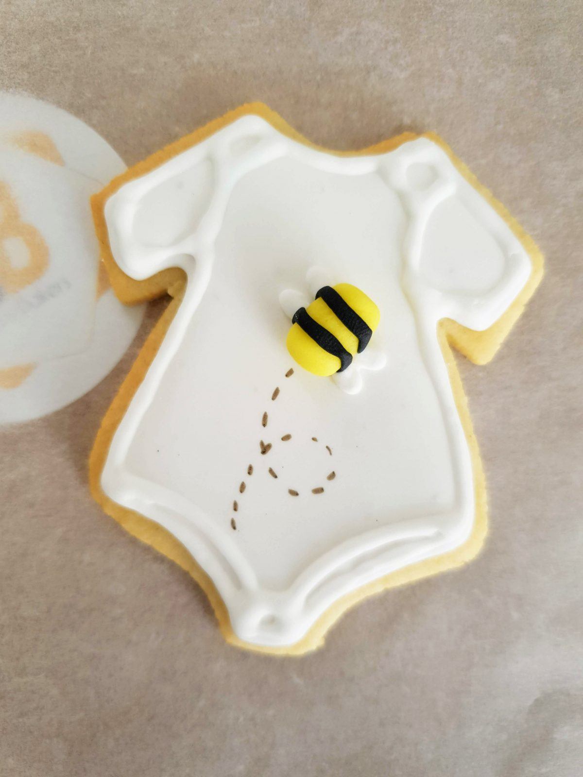 Hand iced and packaged babyshower biscuits baked by Bloom Bakers