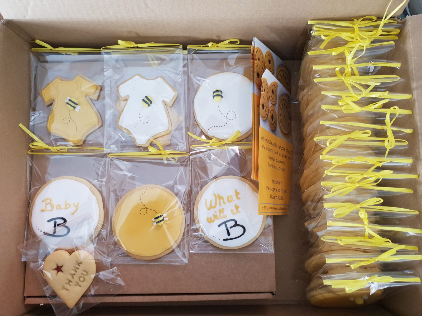 Packaged individual hand iced baby shower biscuits from Bloom Bakers