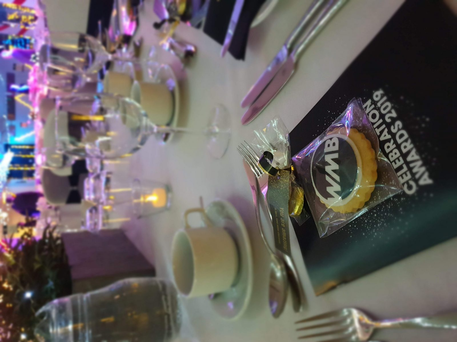 CLose shot of Women mean business award table setting with BLoom Bakers biscuits