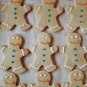 Gingerbread men with AMAZON smile made by Bloom Bakers