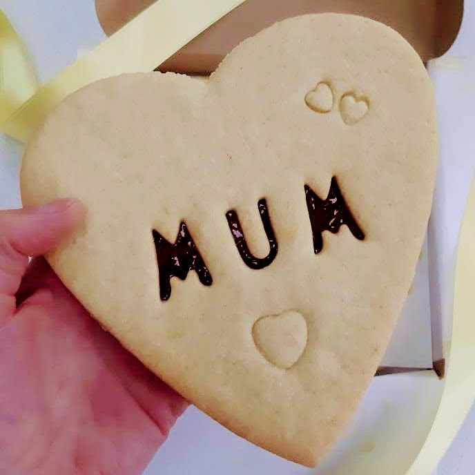 Giant biscuit with mum cut out