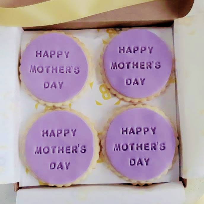 Fondant Mother's Day biscuits impressed with the words Happy Mother's Day