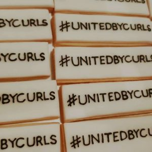 United by curls vegan iced biscuits by Bloom Bakers