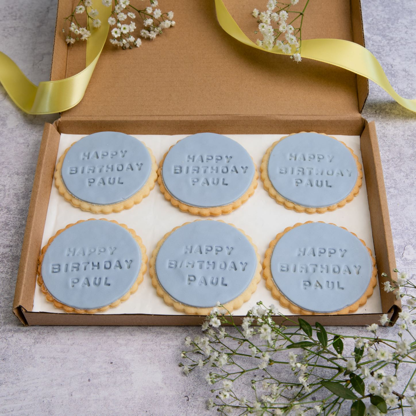 iced birthday biscuits in letterbox friendly packaging