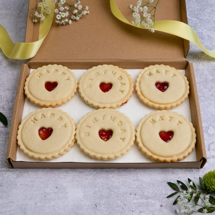 Happy birthday biscuits by bloom bakers