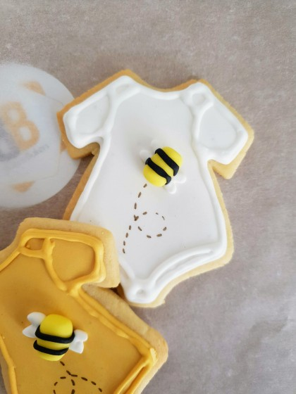 Hand iced and packaged babyshower biscuits bakes by Bloom Bakers