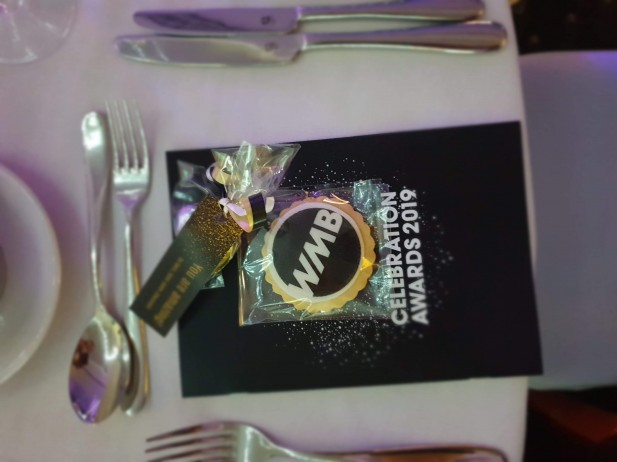 Close up in focus picture of Women mean business award table setting with Bloom Bakers biscuits