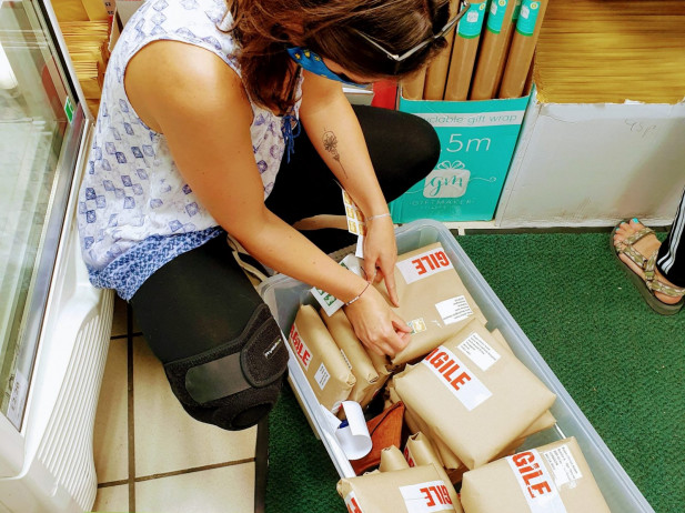 Lisa putting stamps on biscuit boxes
